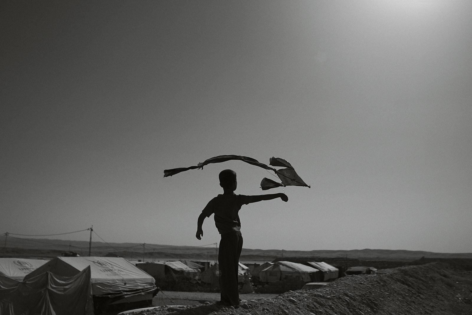 Spielendes Kind mit Drachen
