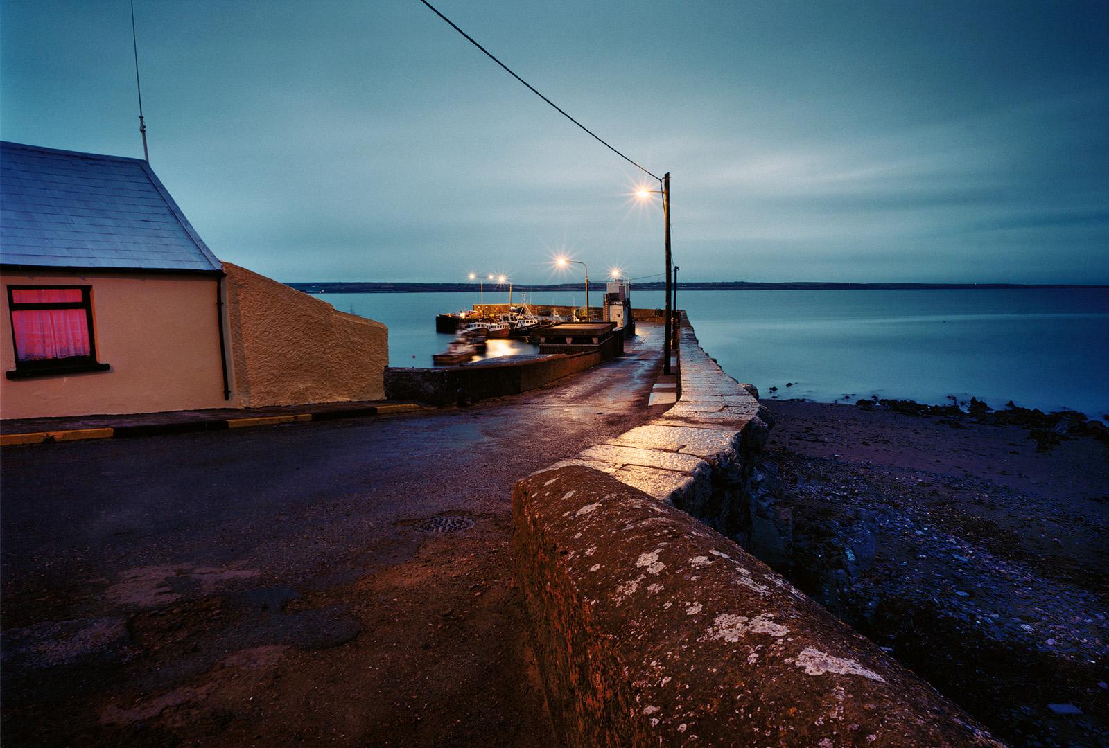 Die Pier im Hafen des Fischerortes Ballycotton Bay im County Cork